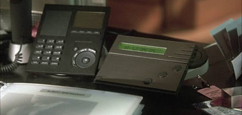 A black coloured answering machine in Rachel Greene's apartment in Paris