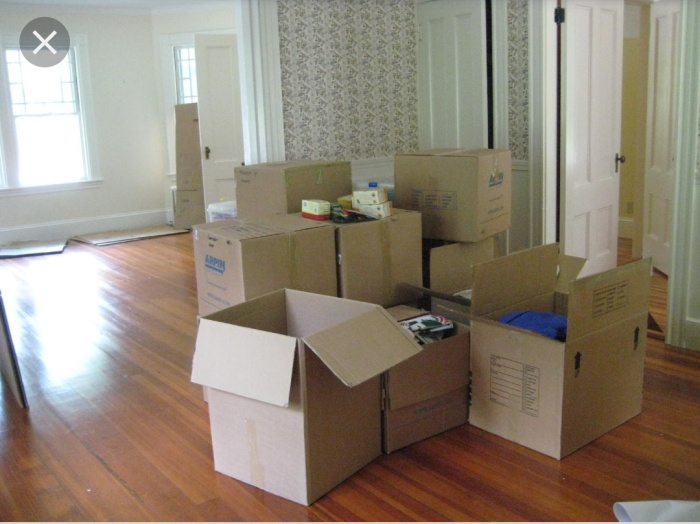 Ross Geller moving into Rachel Greene's apartment. A pile of half opened boxes when moving into a new place