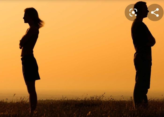 Relationship breakups. A man and a woman in the evening shadow standing opposite to each other. स्त्री पुरुषातलं नातं संबंध सायंकाळी सावलीरूप एकमेकांच्या विरोधात अथवा प्रेमात. प्रेमकथा. Lovers love story
