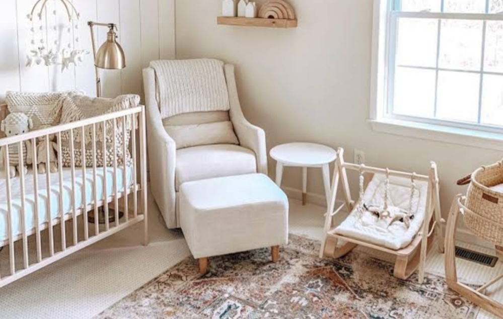 Gender neutral nursery in a suburban house. Off white and cream coloured