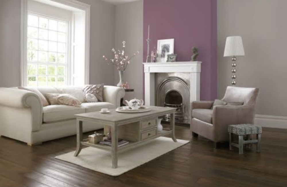 Cream coloured sofa, table and lantern standard furnished living room