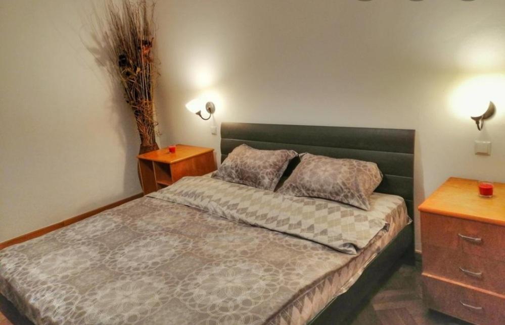 Elegant queen sized bed in a suburban bedroom