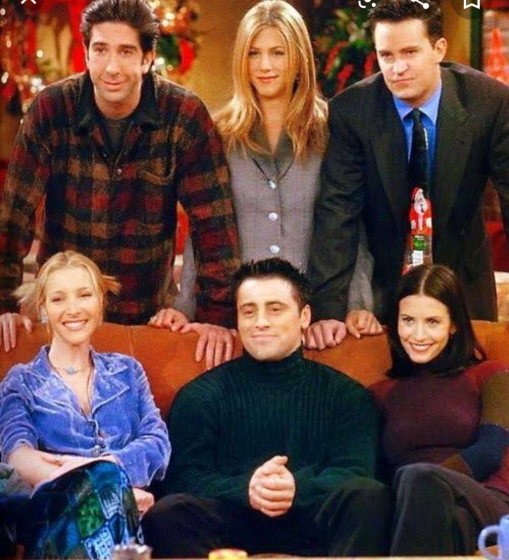 Chandler, Joey, Monica, Phoebe, Rachel and Ross seated on Orange Couch Central Perk Friends Series Finale
